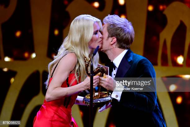 'Fashion' Award Winner Claudia Schiffer thanks Nico Rosberg on stage during the Bambi Awards 2017 show at Stage Theater on November 16 2017 in Berlin...