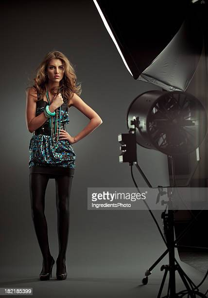 Fashion backstage style portrait of young woman on dark background