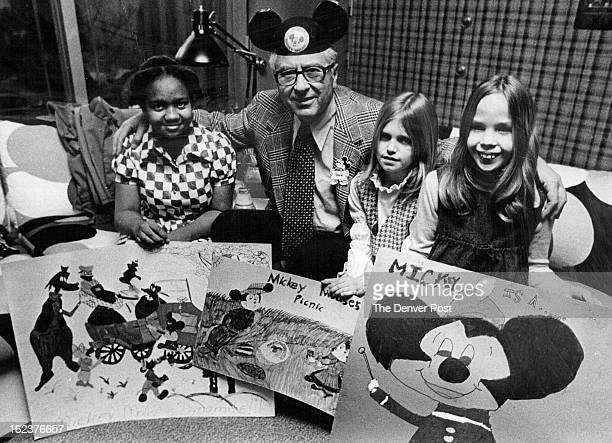 MAR 6 1975 MAR 14 1975 Fashion Bar Plays Host To Poster Contest Winners Jack Levy board chairman of Fashion Bar Stores admires the work of three...