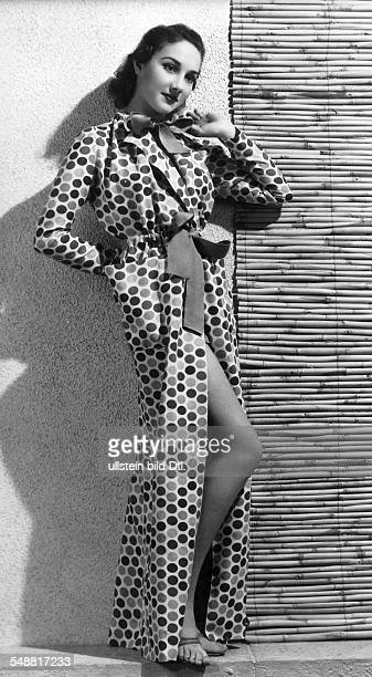 Fashion beach fashion woman in a polkadotted beach coat with red bows Model Schiaparelli 1938 Photographer Atelier Dorvyne Published by 'Die Dame'...