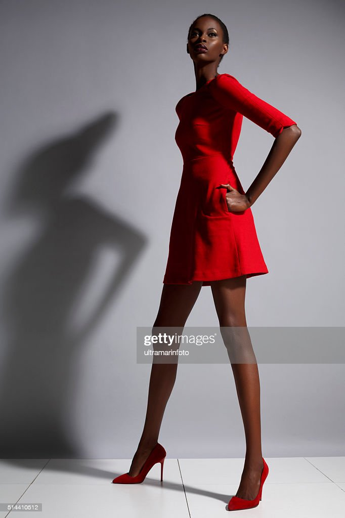 Fashion  Beautiful african ethnicity  young women   Wearing a red dress : Stock Photo