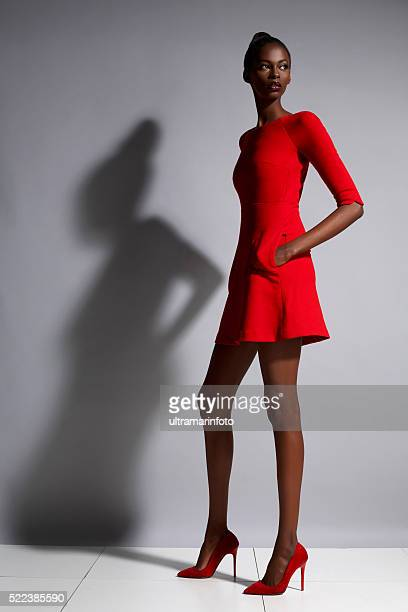 fashion  beautiful african ethnicity  young women   wearing a red dress - skinny black woman stock photos and pictures