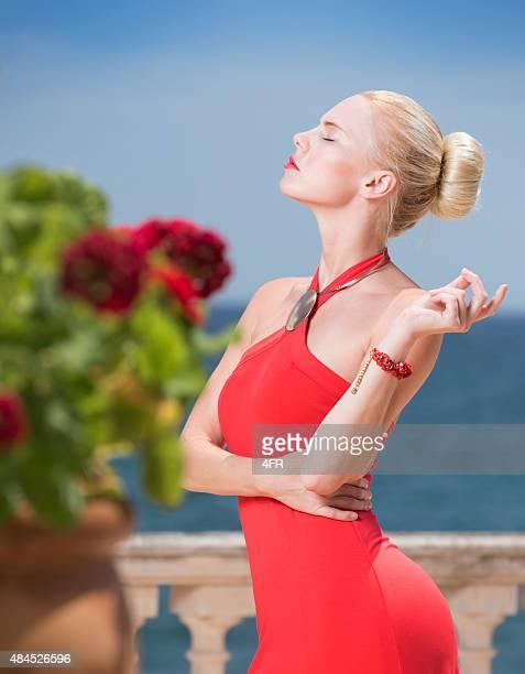 Fashion Beauty, Woman in Red Dress on Balcony