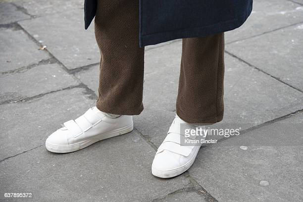Fashion Blogger Abdul Ali wears Zara trainers Rabbit Hole trousers day 1 of London Mens Fashion Week Autumn/Winterr 2017 on January 06 2017 in London...