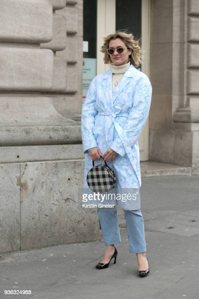 Fashion blogger adenorah AnneLaure Mais wears a Rochas coat Roger Vivier shoes and vintage jeans and sunglasses day 3 of Paris Womens Fashion Week...