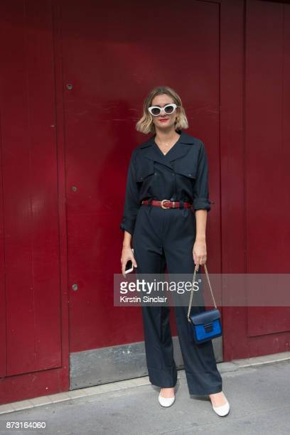 Fashion blogger Adenorah AnneLaure Mais wears a Vanessa Seward bag Valentino shoes Vintage jumpsuit sunglasses and belt day 4 of Paris Womens Fashion...