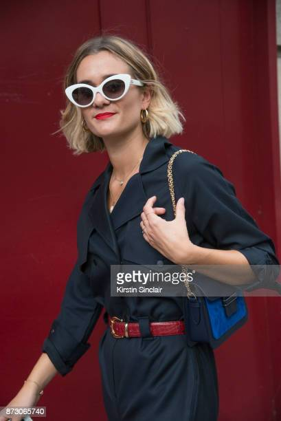 Fashion blogger Adenorah AnneLaure Mais wears a Vintage jumpsuit sunglasses and belt day 4 of Paris Womens Fashion Week Spring/Summer 2018 on...