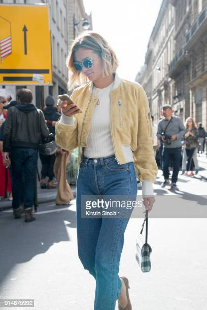 Fashion blogger Adenorah AnneLaure Mais wears an Acne jacket and top Levi'u2019s jeans and Vintage sunglasses day 5 of Paris Womens Fashion Week...
