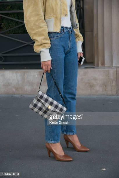 Fashion blogger Adenorah AnneLaure Mais wears an Acne jacket top and shoes Levi'u2019s jeans Mansur Gavriel bag day 5 of Paris Womens Fashion Week...