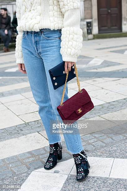 Fashion blogger Adenorah wears a Berenice sweater Levi'u2019s jeans Chanel bag and Isabel Marant boots on day 3 during London Fashion Week...