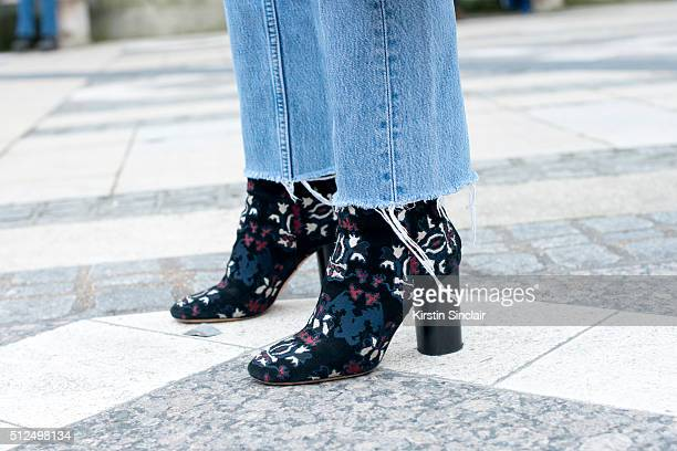 Fashion blogger Adenorah wears Levi'u2019s jeans and Isabel Marant boots on day 3 during London Fashion Week Autumn/Winter 2016/17 on February 21...