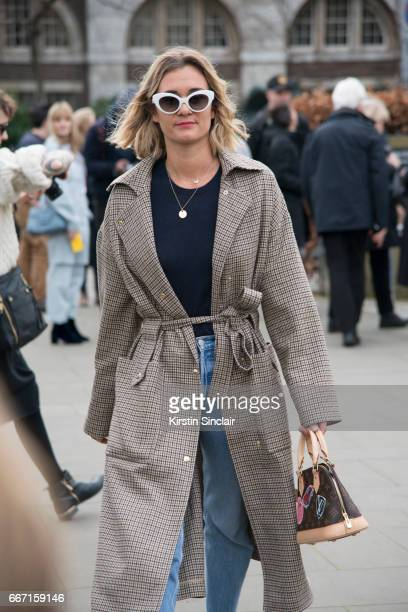 Fashion blogger Adenorah wears Manouska trousers Louis Vuitton bag Levi'u2019s jeans and vintage sunglasses on day 4 of London Womens Fashion Week...