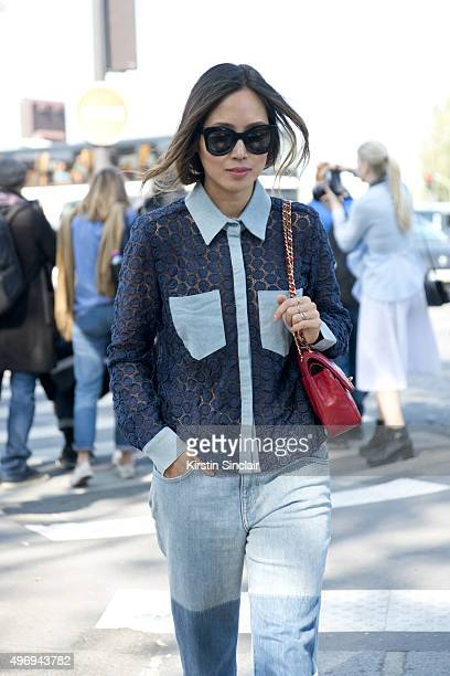 Fashion Blogger Aimee Song wears a Chanel top and bag Wild Fox jeans and Celine sunglasses on day 6 during Paris Fashion Week Spring/Summer 2016/17...