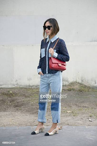 Fashion Blogger Aimee Song wears a Chanel top bag and shoes Wild Fox jeans and Celine sunglasses on day 6 during Paris Fashion Week Spring/Summer...