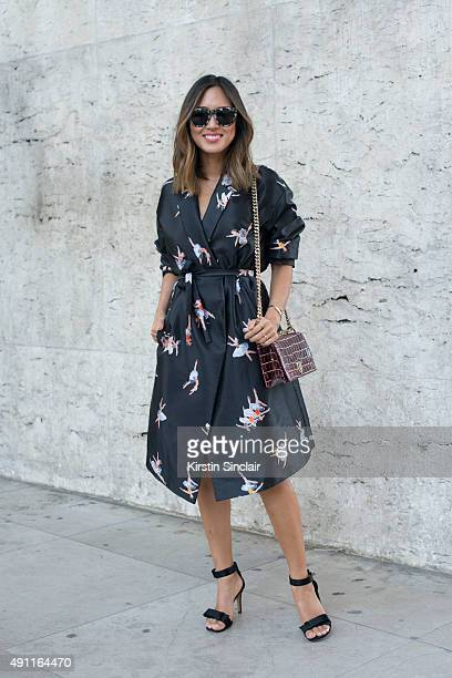 Fashion Blogger Aimee Song wears a Rochas dress Dior bag Celine shoes and Super Retro sunglasses on day 2 during Paris Fashion Week Spring/Summer...