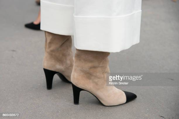 Fashion blogger Aimee Song wears Chanel boots and Tibi trousers day 2 of Paris Womens Fashion Week Spring/Summer 2018 on September 27 2017 in London...