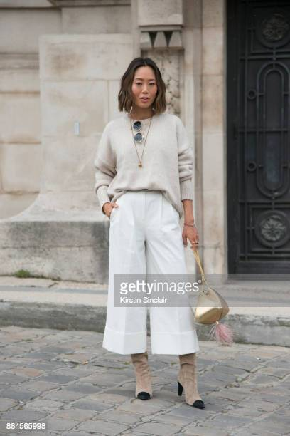 Fashion blogger Aimee Song wears Chanel boots The Volvon bag Something Navy x Treasure Bond sweater and Tibi trousers day 2 of Paris Womens Fashion...