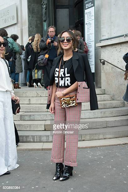 Fashion Blogger Aimee Song who wears all Dior with a Louis Vuitton bag and Christian Louboutin shoes on day 8 during Paris Fashion Week Autumn/Winter...