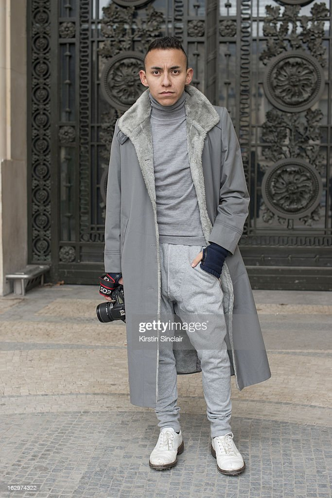Fashion Blogger Alex Norheim wears vintage coat, Acne pants, H and M top, Ecco shoes and Cos gloves. on day 2 of Paris Womens Fashion Week Autumn/Winter 2013 on March 1, 2013 in Paris, France.