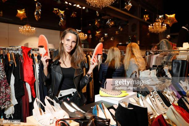 Fashion blogger Alexandra Lapp poses with a pair of shoes at her booth during the BlogBoutique XEdition on December 3 2017 in Cologne Germany
