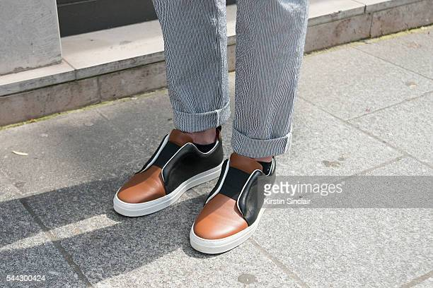 Fashion Blogger Alexandre Chabot wears Maison Kitzume trousers and Pierre Hardy shoes on day 2 of Paris Collections Men on June 23 2016 in Paris...