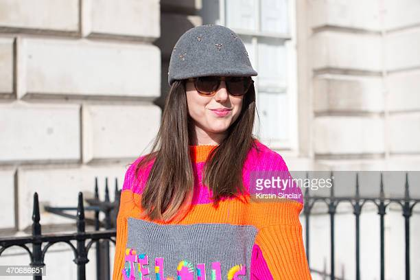 Fashion Blogger Ali T wears a Nadia Zehra sweater Mulberry sunglasses and H and M hat on day 3 of London Collections Women on February 16 2014 in...