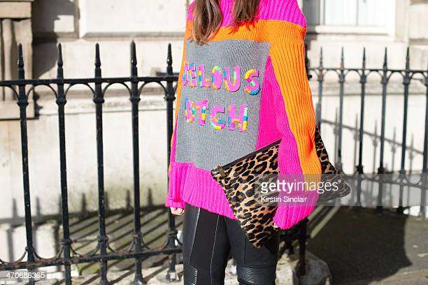 Fashion Blogger Ali T wears Burberry trousers Hobbs bag and jacket Nadia Zehra sweater on day 3 of London Collections Women on February 16 2014 in...
