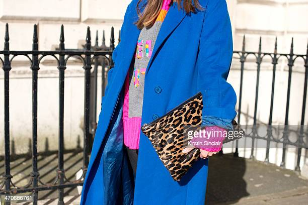 Fashion Blogger Ali T wears Burberry trousers Hobbs bag and jacket Nadia Zehra sweater Mulberry sunglasses and H and M hat on day 3 of London...