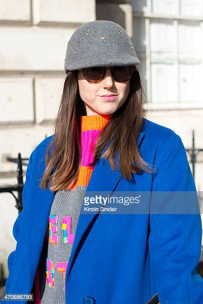 Fashion Blogger Ali T wears Hobbs jacket Nadia Zehra sweater Mulberry sunglasses and H and M hat on day 3 of London Collections Women on February 16...