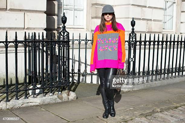 Fashion Blogger Ali T wears Justin Deakin shoes Burberry trousers Hobbs bag Nadia Zehra sweater Mulberry sunglasses and H and M hat on day 3 of...