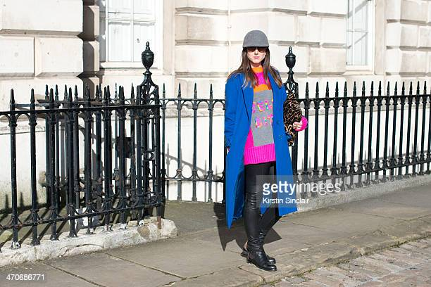 Fashion Blogger Ali T wears Justin Deakin shoes Burberry trousers Hobbs bag and jacket Nadia Zehra sweater Mulberry sunglasses and H and M hat on day...