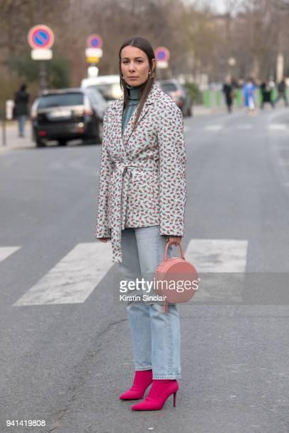Fashion blogger Alice Barbier wears a Rochas jacket Mansur Gavriel bag Levis jeans Mango boots and an Acne sweater day 3 of Paris Womens Fashion Week...