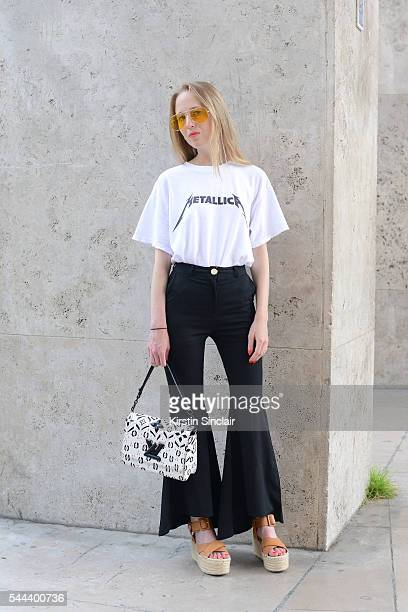 Fashion Blogger Alice Zielasko wears a Louis Vuitton bag Tony Bianco shoes vintage trousers glasses and Metallica T shirt on day 3 of Paris...