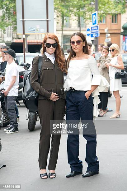 Fashion blogger Amber Venz Box wears a Carven jumpsuit Alexander Wang shoes Celine sunglasses and a Balenciaga bag with Fashion Blogger of Style...