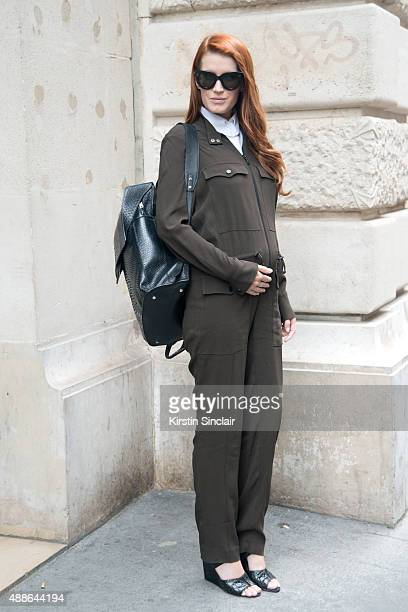 Fashion blogger Amber Venz Box wears a Carven jumpsuit Alexander Wang shoes Celine sunglasses and a Balenciaga bag on day 4 of Paris Fashion Week...