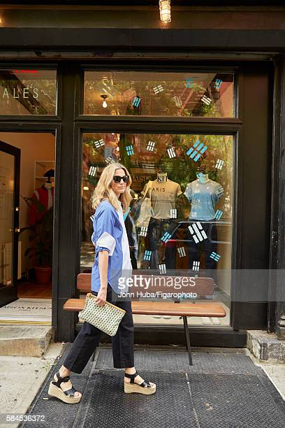 Fashion blogger and author Amanda Brooks is photographed for Madame Figaro on July 15 2015 in New York City Shirt pants shoes clutch PUBLISHED IMAGE...