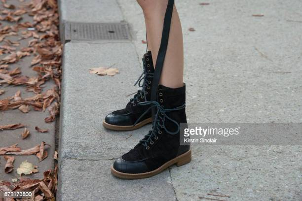 Fashion blogger and designer Yoyo Cao wears Chanel boots day 4 of Paris Womens Fashion Week Spring/Summer 2018 on September 29 2017 in London England