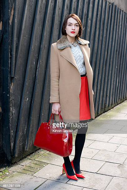 Fashion Blogger and Journalist Ella Catliff wears a Lulu Guiness bag Coach shoes skirt and jumper Sandro coat and a Whistles shirt day 1 of London...