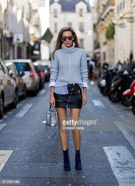 Fashion blogger and model Alexandra Lapp wearing a blue turtleneck sweater leather skirt Dior bag and velvet boots on October 2 2016 in Paris France