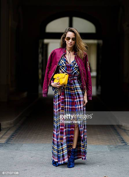 Fashion blogger and model Alexandra Lapp wearing a plaid dress from L'Agence Schott NYC bomber jacket Phillip Lim velvet boots Ray Ban sunglasses...