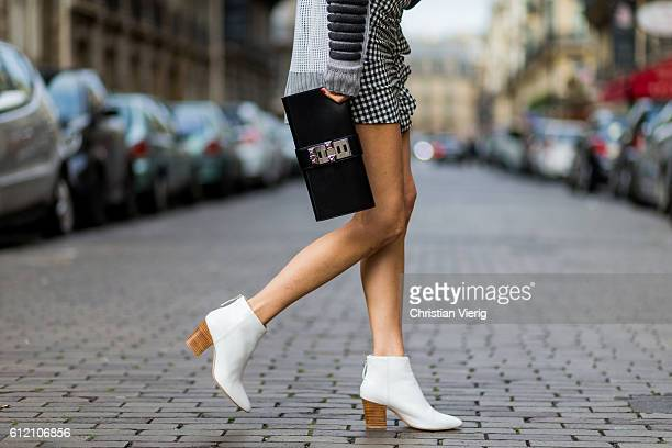 Fashion blogger and model Alexandra Lapp wearing a Prabal Gurung sweater Zara mini skirt Zara boots Le Specs sunglasses Hermes clutch on October 2...