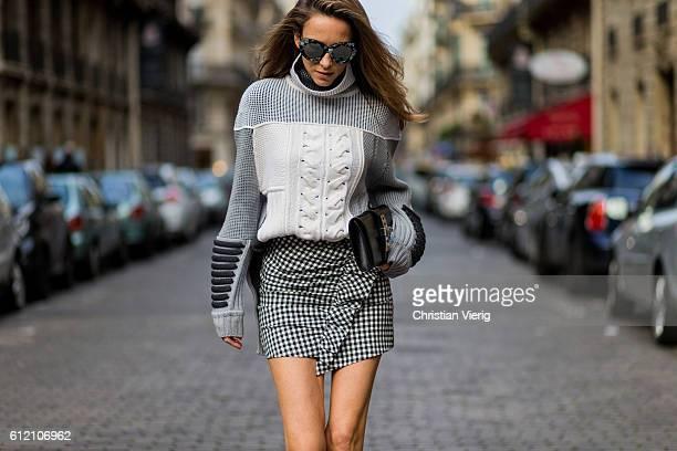 Fashion blogger and model Alexandra Lapp wearing a Prabal Gurung sweater Zara mini skirt Zara boots Le Specs sunglasses Hermes clutch on October 2...