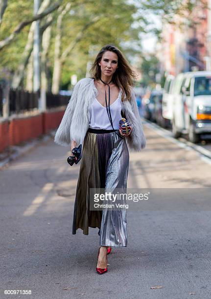 Fashion blogger and model Alexandra Lapp wearing a skirt from Max Co a top from Jadicted a fur jacket from Steffen Schraut Alexander McQueen clutch...