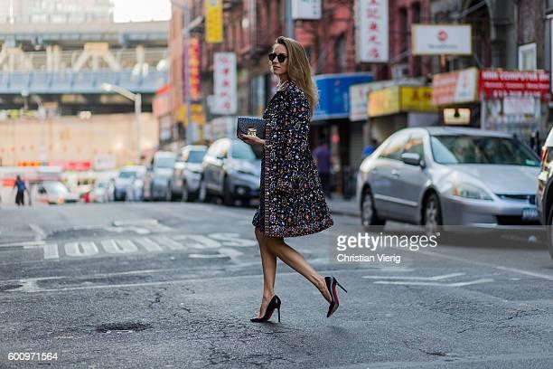 Fashion blogger and model Alexandra Lapp wearing Steffen Schraut dress and coat Monokel sunglasses Furla bag Christian Louboutin heels on September 8...