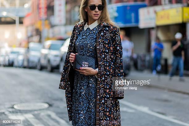 Fashion blogger and model Alexandra Lapp wearing Steffen Schraut dress and coat Monokel sunglasses Furla bag on September 8 2016 in New York City