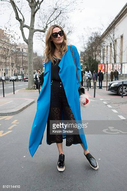 Fashion blogger and model Lima Che wears a Pinko top and trousers Chanel bag Fendi Pom Pom Celine sunglasses and Stella McCartney shoes on day 4 of...