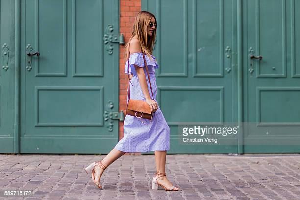 da4e085ddc71cb Fashion Blogger and Owner of SCIC Swimwear Sofia Grau wearing a blue off  shoulder HM button