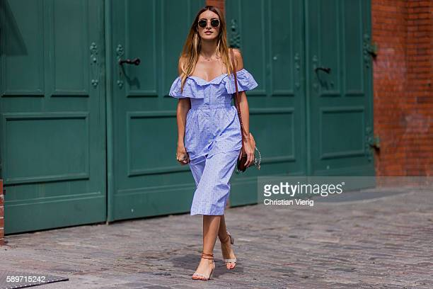 Fashion Blogger and Owner of SCIC Swimwear Sofia Grau wearing a blue off shoulder HM button dress a Chloe faye bag round Ray Ban sunglasses Alexander...