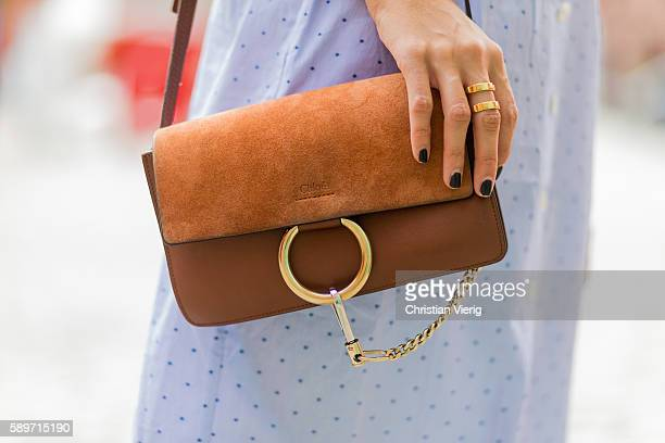 Fashion Blogger and Owner of SCIC Swimwear Sofia Grau wearing a Chloe faye bag a golden Ina Beissner ring and black nail polish on August 15 2016 in...