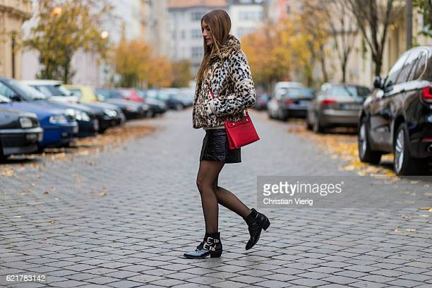 Fashion Blogger and Owner of SCIC Swimwear Sofia Grau wearing a leopard printed fake fur coat Express a beige Sweater other stories a black leather...